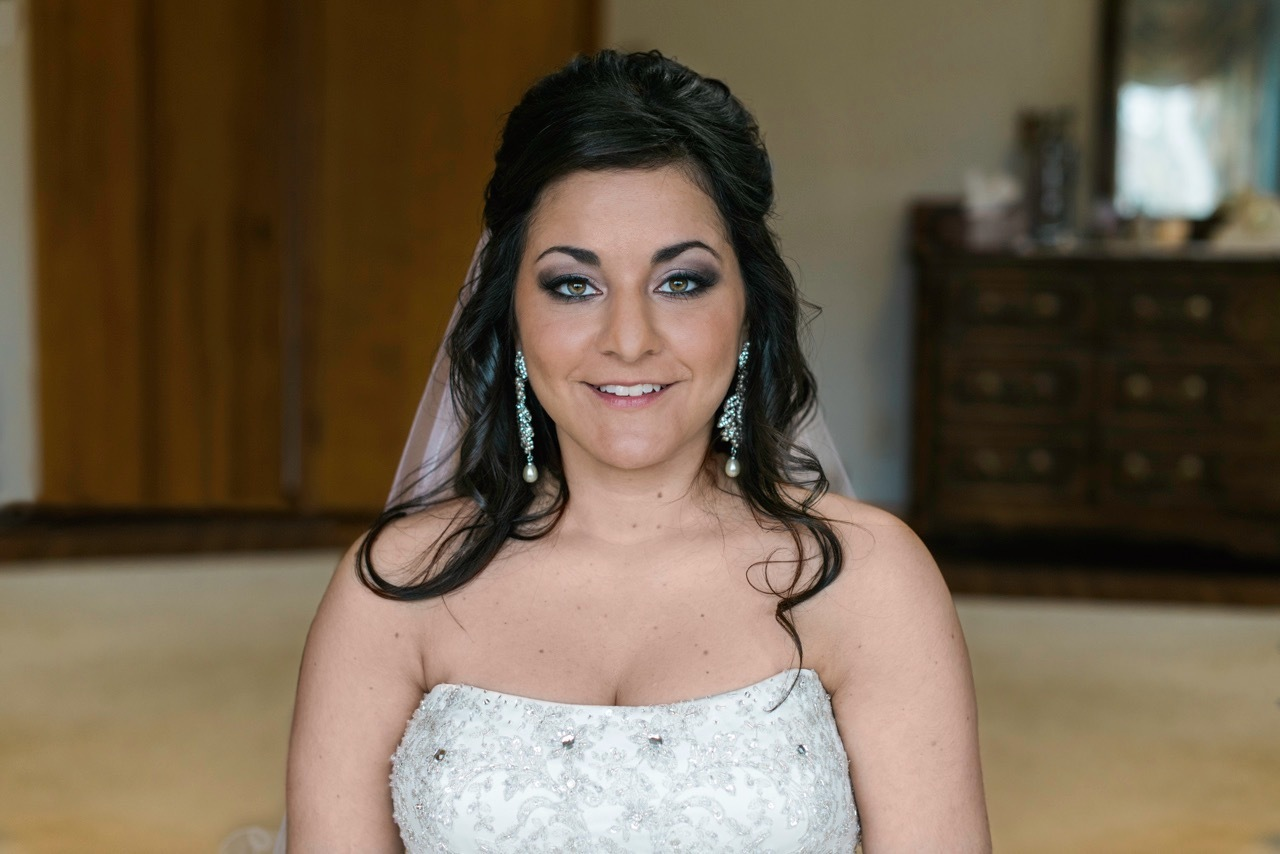 Bride about to walk out and show everyone in her family how beautiful she looks