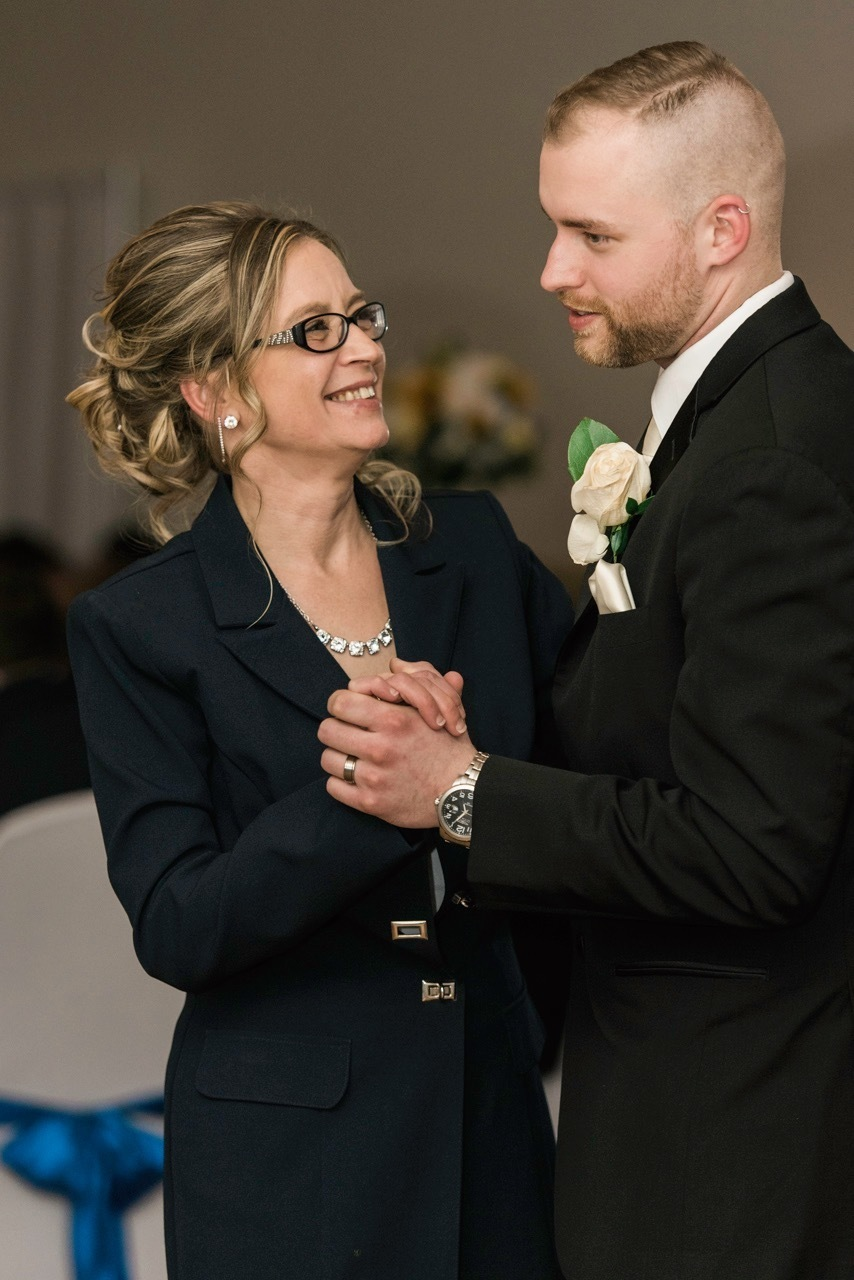 A groom dances with his mom