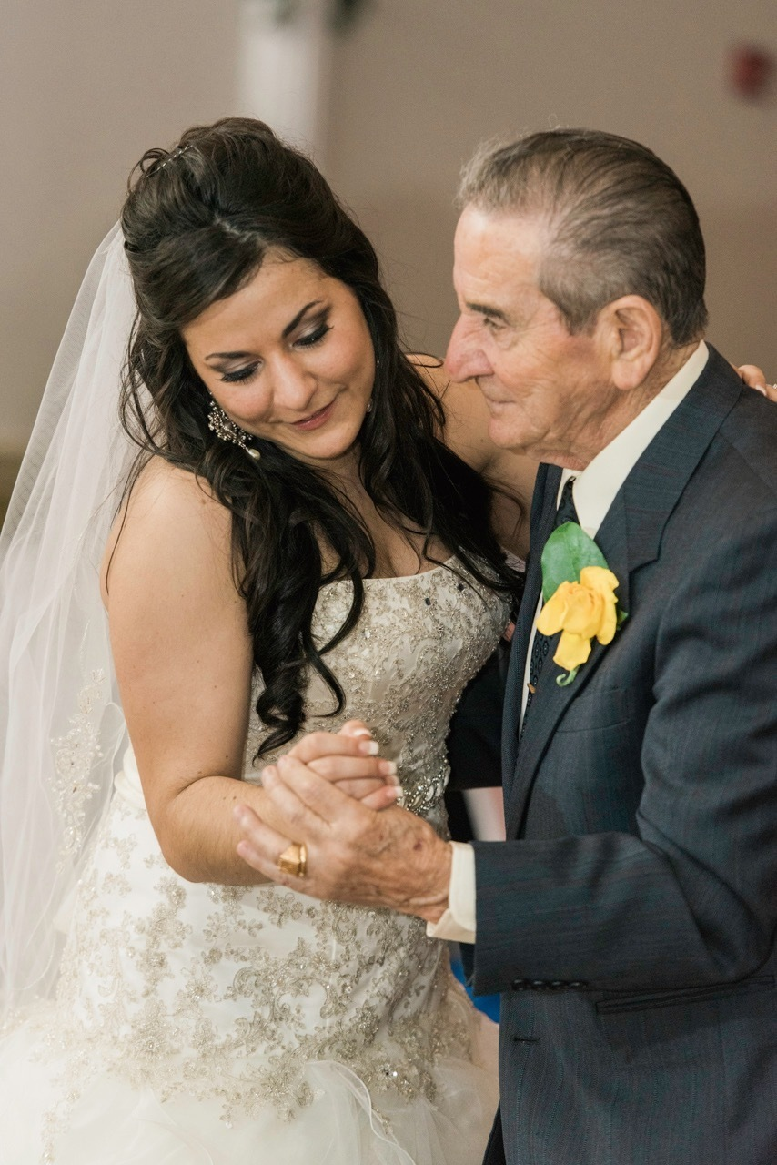 A bride dances with her Grandfather