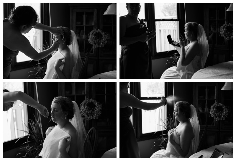 A bride has makeup applied before her wedding.