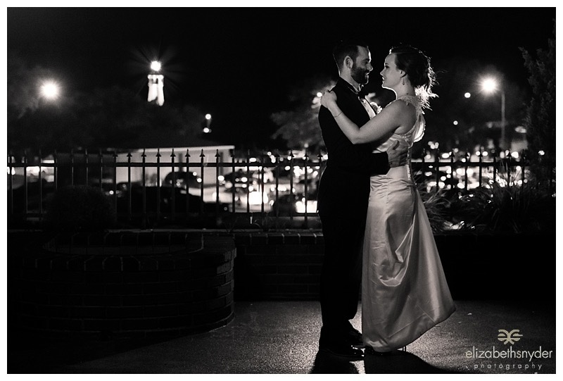 A bridal portrait at night on a rooftop patio.