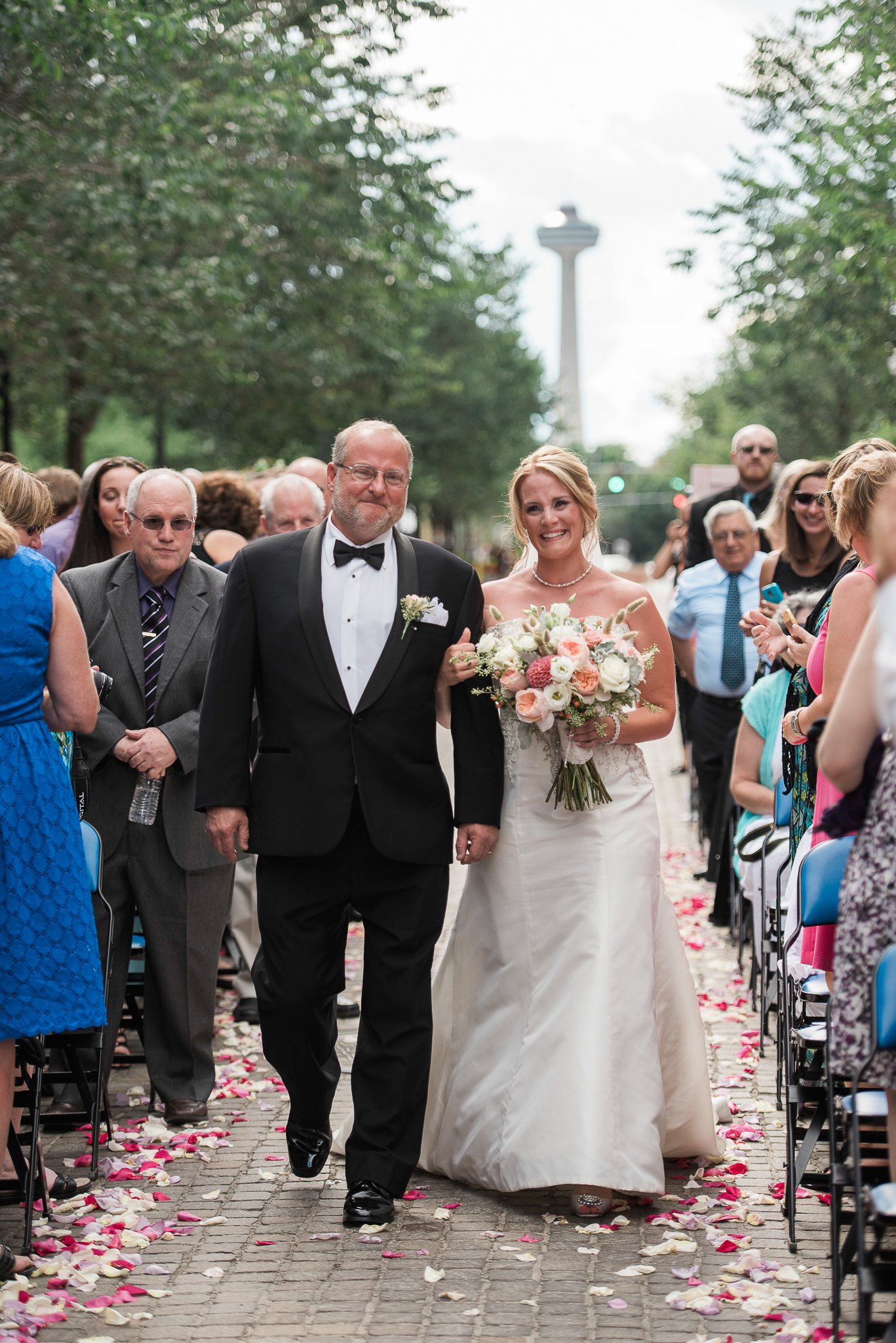 A bride walks down the aisle with her dad in Niagara Falls, NY
